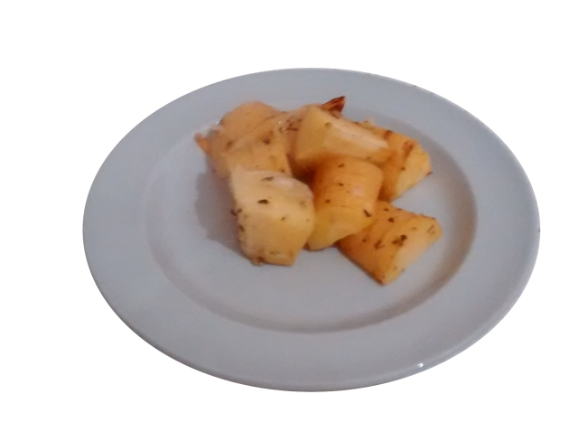 A photograph of roast parsnip chunks on a blue-grey plate