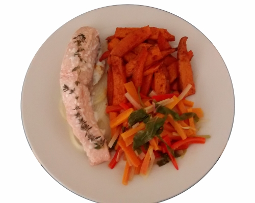 photograph of a cooked salmon fillet, served with sweet potato wedges and stir-fried vegetables