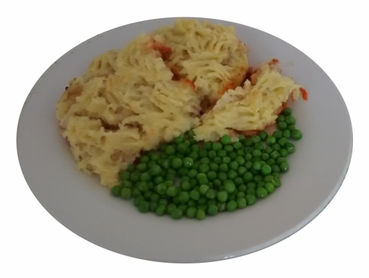 Photograph of a generous serving of cottage pie and peas on a white plate