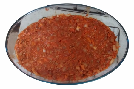 Photograph of an oval glass dish filled with a smooth layer of savoury mince