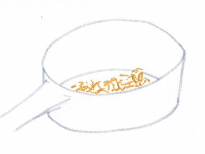 Hand drawing of a saucepan with a thin layer of onion on the bottom