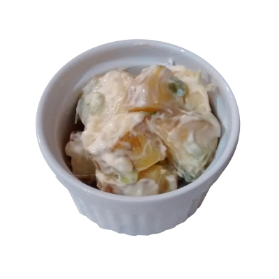 Photograph of a white dish containing potato salad