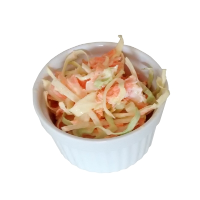 Photograph of coleslaw in a white ceramic dish