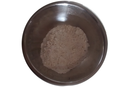 Photograph of a mixing bowl full of dry ingredients